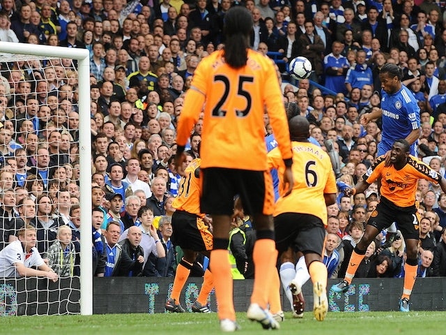 Chelsea's Ivorian striker Didier Drogba scores his second goal during the English Premier League football match between Chelsea and Wigan Athletic at Stamford Bridge in London, England on May 9, 2010