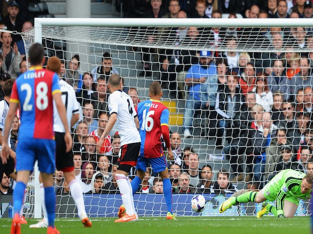 Dwight Gayle of Crystal Palace scores the opening goal during the Barclays Premier League match between Fulham and Crystal Palace at Craven Cottage on May 11, 2014