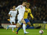 England defender Gary Cahill wrestles for possession with Brazilian striker Neymar on February 06, 2013.