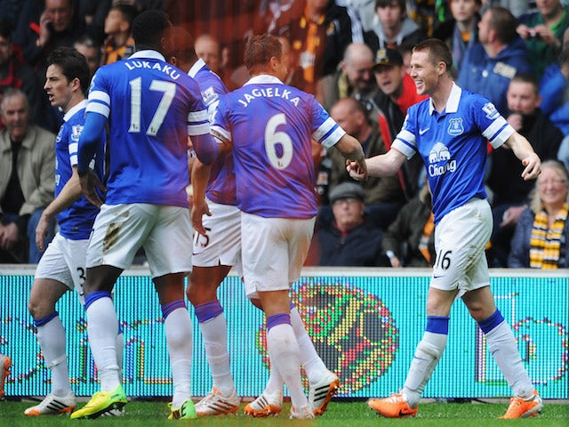 James McCarthy (R) of Everton celebrates scoring the opening goal with team mates during the Barclays Premier League match between Hull City and Everton at KC Stadium on May 11, 2014