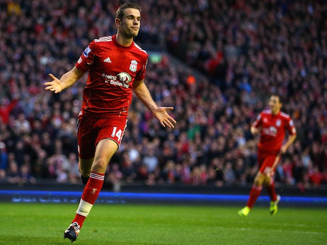 Jordan Henderson of Liverpool celebrates scoring their second goal during the Barclays Premier League match between Liverpool and Chelsea at Anfield on May 8, 2012