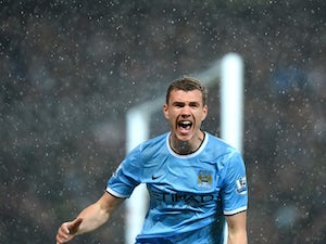 Dzeko expects title race with Chelsea