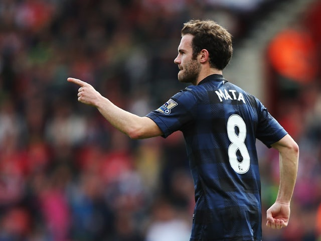Juan Mata of Manchester United celebrates scoring during the Barclays Premier League match between Southampton and Manchester United at St Mary's Stadium on May 11, 2014