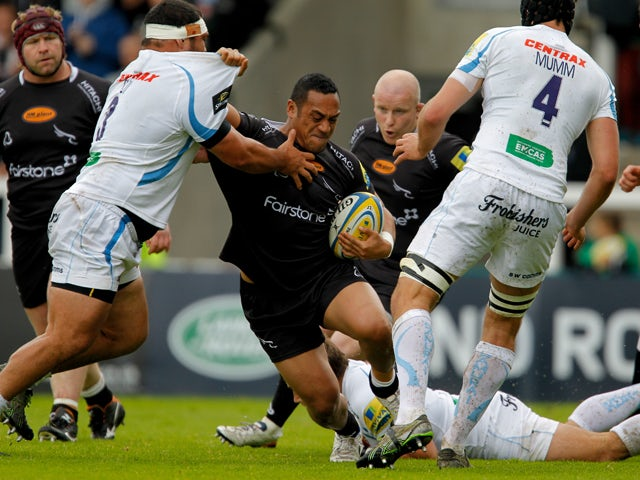Sinoti Sinoti of Newcastle Falcons forces his way past Hoana Tui of Exeter Chiefs during the Aviva Premiership match between Newcastle Falcons and Exeter Chiefs at Kingston Park on May 10, 2014