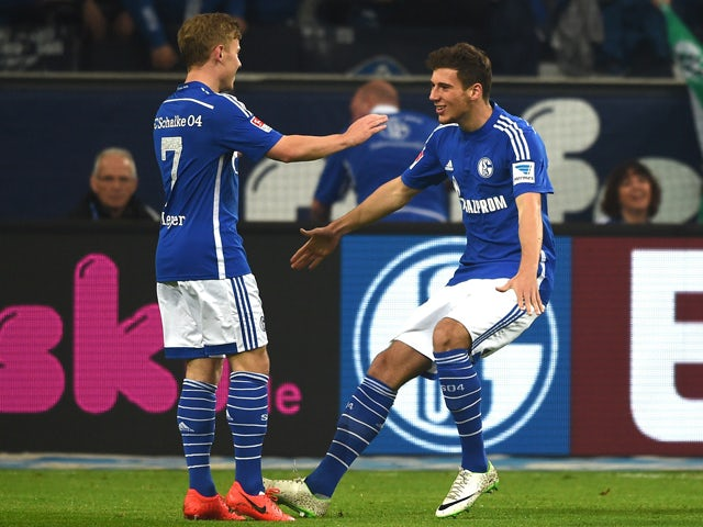 Schalke's midfielder Max Meyer and Schalke's midfielder Leon Goretzka celebrate after their team scored during the German first division Bundesliga football match FC Schalke 04 vs 1 FC Nuremberg in Gelsenkirchen, western Germany on May 10, 2014