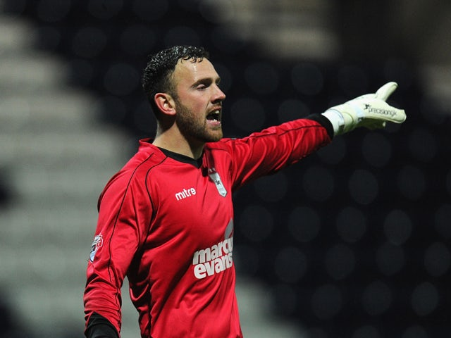 Ipswich keeper Scott Loach in action during the Budweiser FA Cup Third Round Replay between Preston North End and Ipswich Town at Deepdale on January 14, 2014