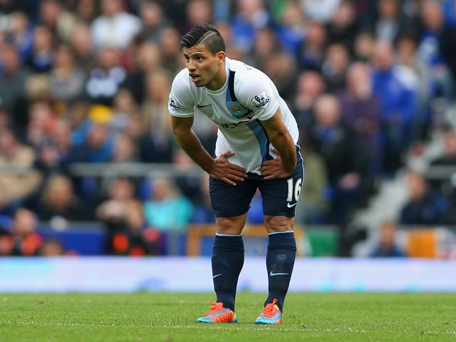 Sergio Aguero of Manchester City reacts after sustaining an injury during the Barclays Premier League match between Everton and Manchester City at Goodison Park on May 3, 2014