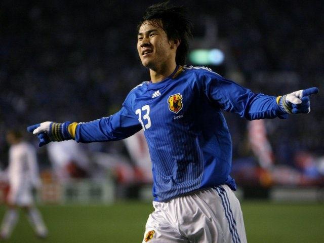 Shinji Okazaki celebrates scoring for Japan on February 04, 2009.