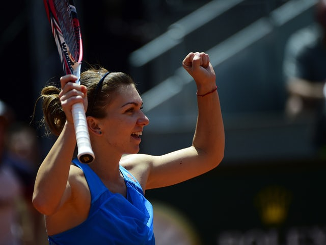 Romanian tennis player Simona Halep celebrates her victory over Czech tennis player Petra Kvitova during their women's singles semifinal tennis match of the Madrid Masters at the Magic Box (Caja Magica) sports complex in Madrid on May 10, 2014