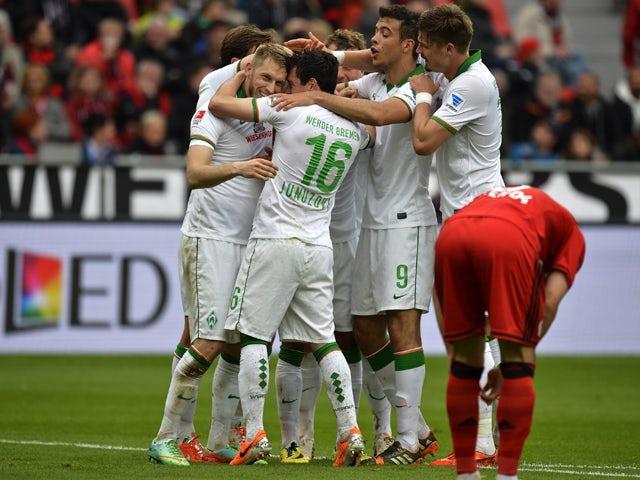 Bremen's players celebrate scoring during the German first division Bundesliga football match Bayer 04 Leverkusen vs SV Werder Bremen, in Leverkusen, western Germany on May 10, 2014