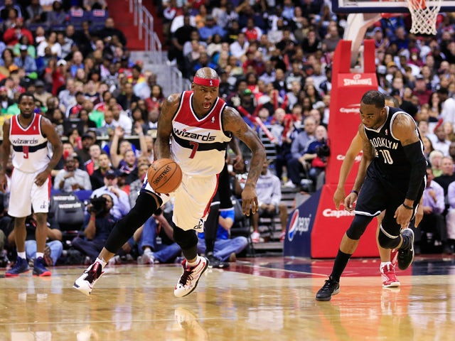 Al Harrington #7 of the Washington Wizards steals the ball from Marcus Thornton #10 of the Brooklyn Nets during the second half of the Wizards 101-94 win at Verizon Center on March 15, 2014