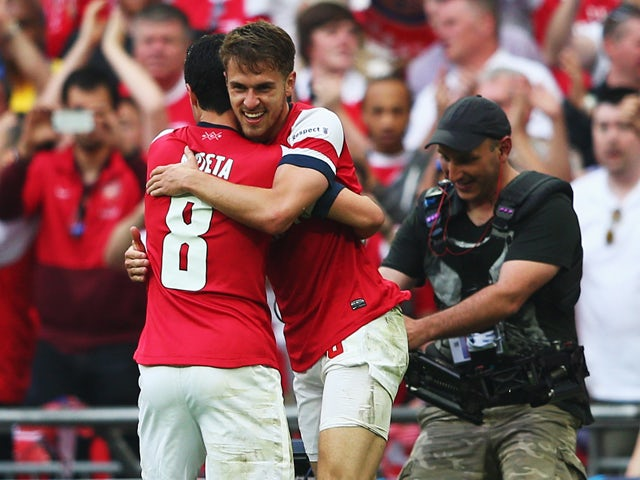 Aaron Ramsey of Arsenal celebrates with Mikel Arteta as he scores their third goal during the FA Cup with Budweiser Final match between Arsenal and Hull City at Wembley Stadium on May 17, 2014