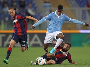 Balde Diao Keita (C) of SS Lazio competes for the ball with Diego Laxalt (L) and Michele Pazienza of Bologna FC during the Serie A match on May 18, 2014