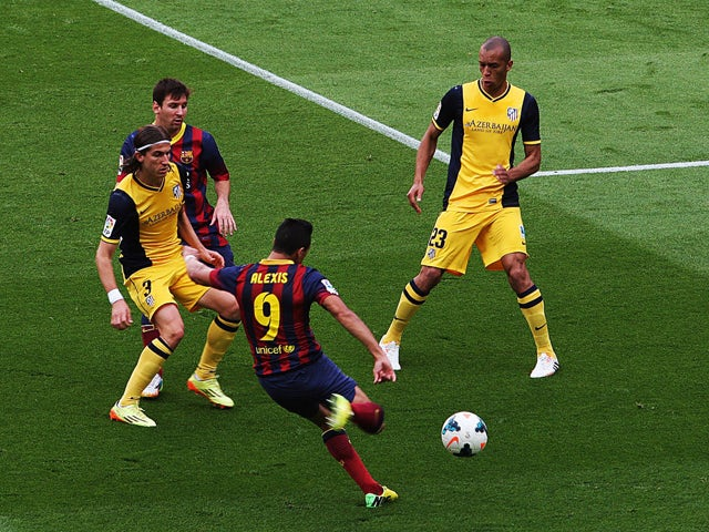 Barcelona's Chilean forward Alexis Sanchez scores the opener during the Spanish league football match FC Barcelona vs Club Atletico de Madrid at the Camp Nou stadium in Barcelona on May 17, 2014