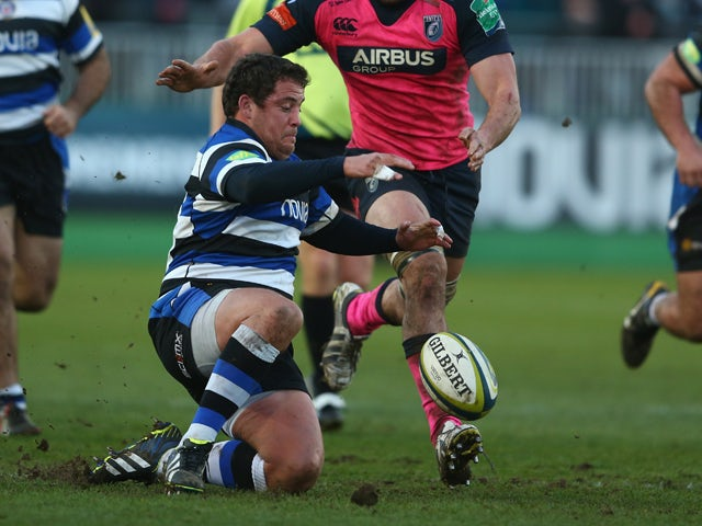 Eusebio Guinazu of Bath pounces on the loose ball as James Down of Cardiff Blues loses in during the LV Cup match between Bath and Cardiff Blues at the Recreation Ground on January 25, 2014