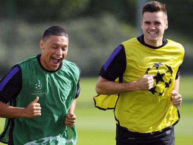 Carl Jenkinson and Alex Oxlade-Chamberlain joke during an Arsenal training session on September 17, 2012.