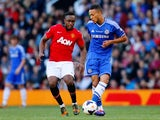 Charni Ekangamene of Manchester United in action with Lewis Baker of Chelsea during the Barclays Under-21 Premier League Final match between Manchester United and Chelsea at Old Trafford on May 14, 2014