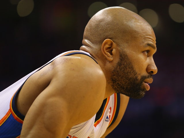 Derek Fisher #6 of the Oklahoma City Thunder in Game Two of the Western Conference Quarterfinals during the 2014 NBA Playoffs at Chesapeake Energy Arena on April 21, 2014