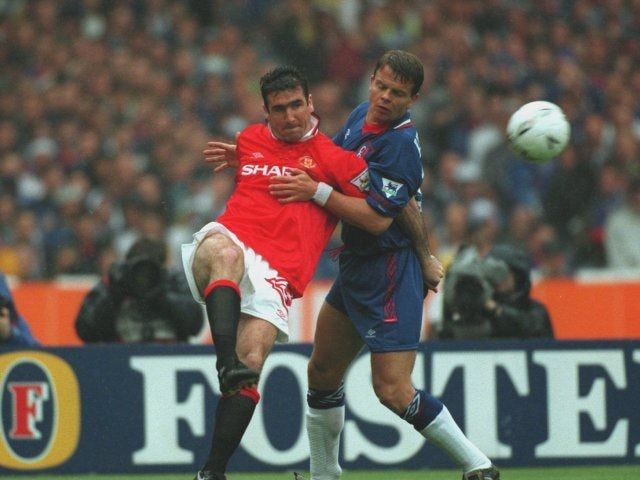Manchester United striker Eric Cantona passes the ball during the FA Cup final on May 14, 1994.