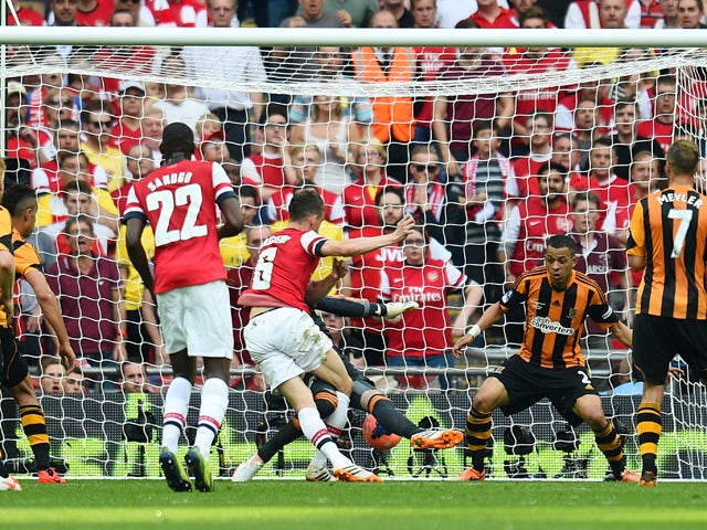 Laurent Koscielny of Arsenal scores their second goal during the FA Cup with Budweiser Final match between Arsenal and Hull City at Wembley Stadium on May 17, 2014
