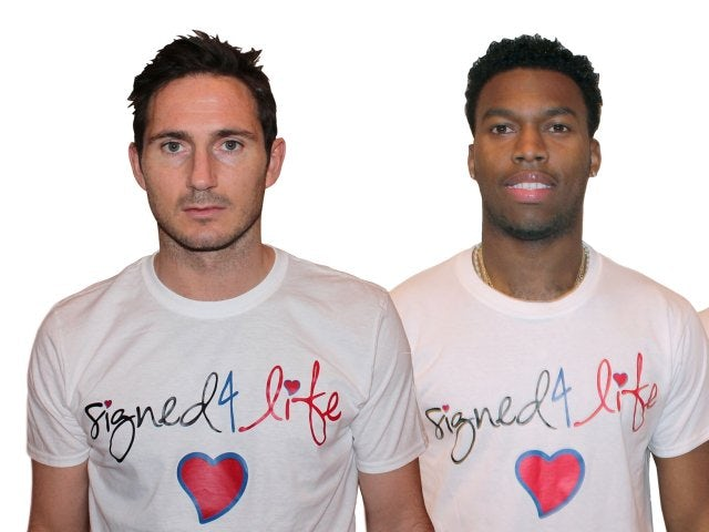 Chelsea's Frank Lampard and Liverpool striker Daniel Sturridge model Signed 4 Life t-shirts.
