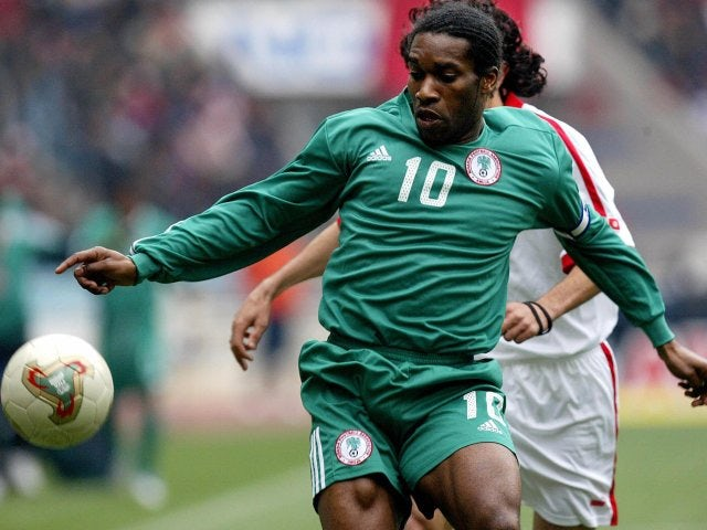Former Bolton Wanderers midfielder Jay Jay Okocha in action for Nigeria on February 11, 2004.