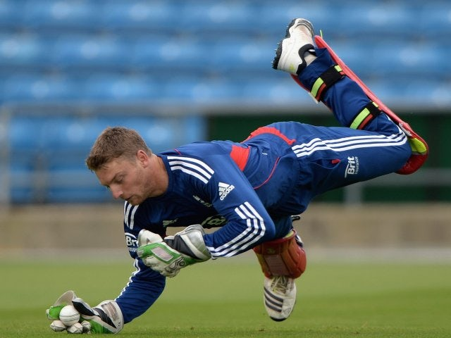 Jos Buttler takes a catch during an England training session on September 05, 2013.