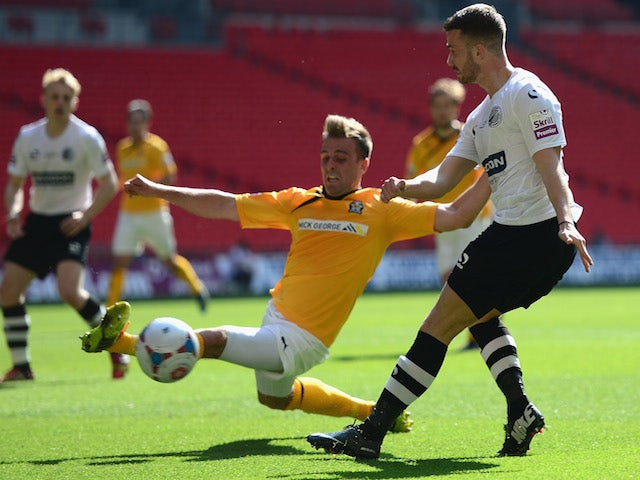 Liam Hughes of Cambridge United battles with Phil Turnbull of Gateshead United during the Skrill Conference Premier Play-Offs Final on May 18, 2014
