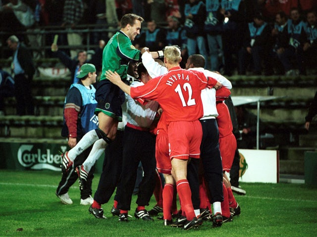 Liverpool players celebrate after Delfi Geli of Alaves scores an own goal to give Liverpool victory in the UEFA Cup Final between Liverpool and Deportivo Alaves on May 16, 2001