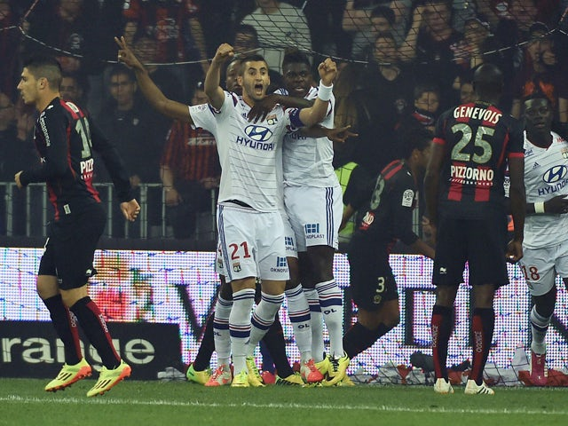 Lyon's players celebrate after Burkinabese defender Bakary Kone scored a goal during a French L1 football match between Nice and Lyon at the Allianz Riviera Stadium in Nice, southern France, on May 17, 2014