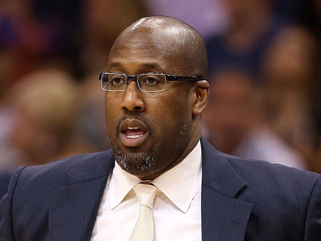 Head coach Mike Brown of the Cleveland Cavaliers watches from the bench during the NBA game against the Phoenix Suns at US Airways Center on March 12, 2014
