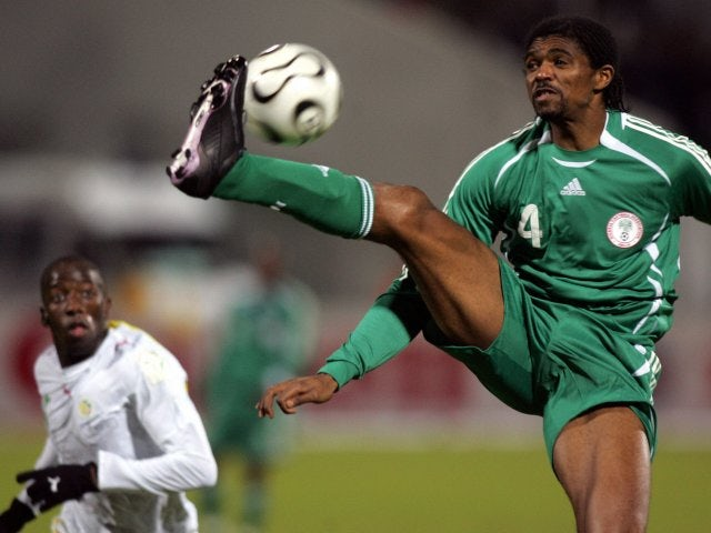 Former Arsenal striker Nwankwo Kanu in action for Nigeria on January 31, 2006.