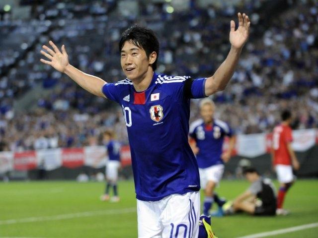 Manchester United playmaker Shinji Kagawa celebrates scoring for Japan against South Korea on August 10, 2011.