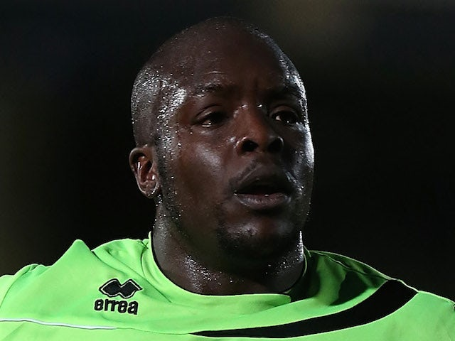 Adebayo Akinfenwa of Northampton Town in action during the npower League Two match between Wycombe Wanderers and Northampton Town at Adams Park on April 16, 2013