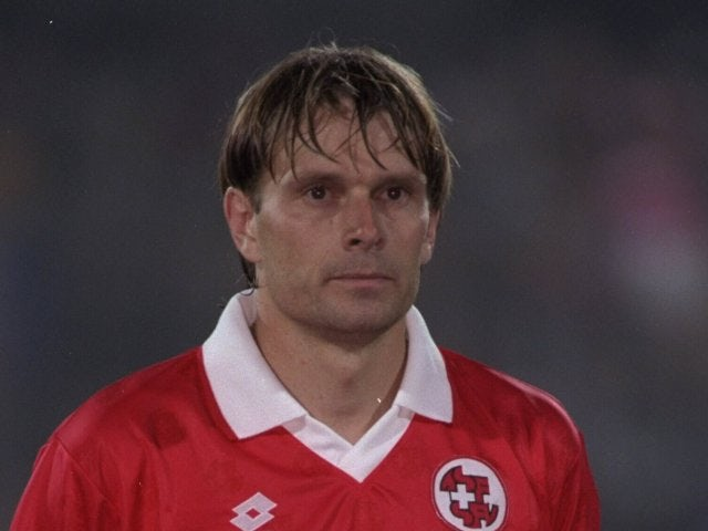 Alain Geiger awaits the Switzerland national anthem on October 11, 1995.