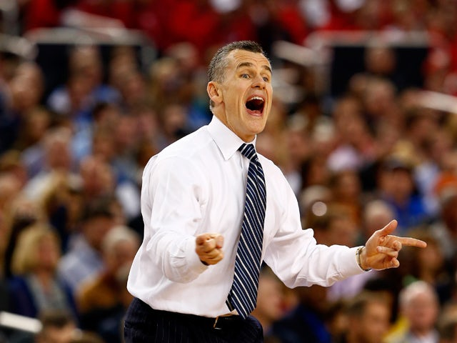 Head coach Billy Donovan of the Florida Gators motions to his players during the NCAA Men's Final Four Semifinal against the Connecticut Huskies at AT&T Stadium on April 5, 2014