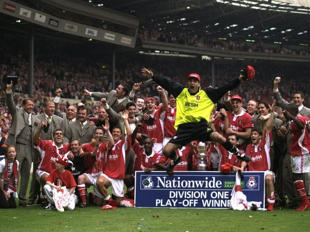 Charlton Athletic players celebrate earning promotion to the Premier League at Wembley on May 25, 1998.