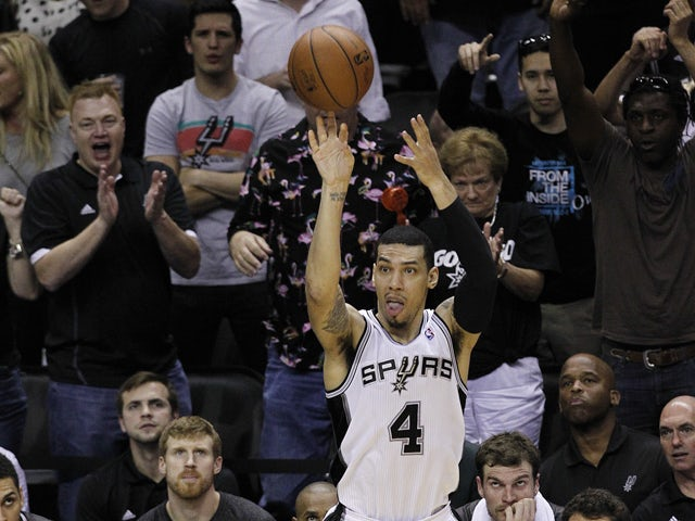 Danny Green #4 of the San Antonio Spurs shoots a three point shot against the Oklahoma City Thunder in Game Two of the Western Conference Finals during the 2014 NBA Playoffs at the AT&T Center on May 21, 2014