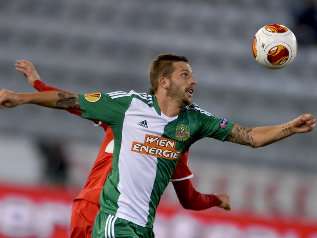SK Rapid Wien's midfielder Guido Burgstaller tries to head the ball during the Europa League group G football match between FC Thun and SK Rapid Wien on September 19, 2013