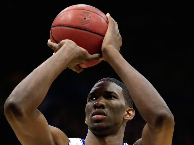 Joel Embiid #21 of the Kansas Jayhawks shoots a free throw during the game against the Iowa State Cyclones at Allen Fieldhouse on January 29, 2014