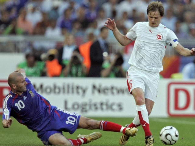 Switzerland's Johann Vogel hurdles a challenge from France midfielder Zinedine Zidane on June 13, 2006.