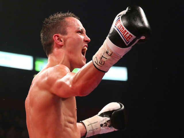 Josh Warrington celebrates after stopping Rendall Munroe during the Commonwealth Featherweight Title fight on April 19, 2014
