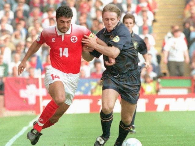 Switzerland's Kurbilay Turkyilmaz battles for possession against Scotland on June 18, 1996.