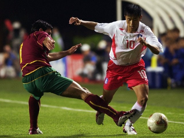South Korea full-back Lee Young-pyo dribbles past Portugal winger Luis Figo on June 14, 2002.