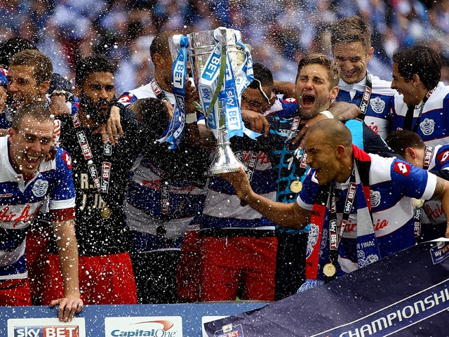 : The QPR team celebrate with the trophy after the Sky Bet Championship Playoff Final match between Derby County and Queens Park Rangers at Wembley Stadium on May 24, 2014