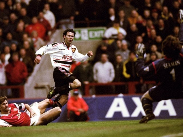 Manchester United's Ryan Giggs lashes a shot past Arsenal goalkeeper David Seaman on April 14, 1999.