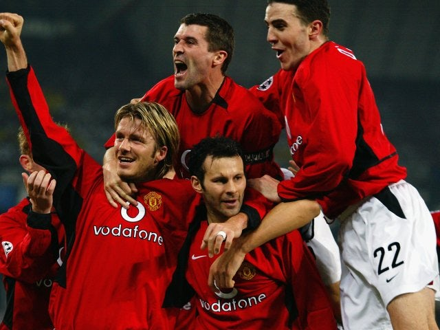 Ryan Giggs is mobbed by his Manchester United teammates after scoring against Juventus on February 25, 2003.