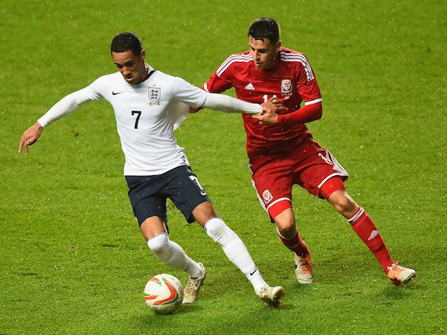 Tom Ince of England battles with Tom O'Sullivan of Wales during the 2015 UEFA European U21 Championships Qualifier on May 19, 2014