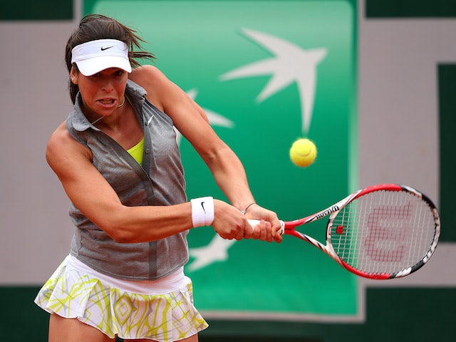Ajla Tomljanovic of Croatia returns a shot in her women's singles match against Carla Suarez Navarro of Spain on day eight of the French Open at Roland Garros on June 1, 2014