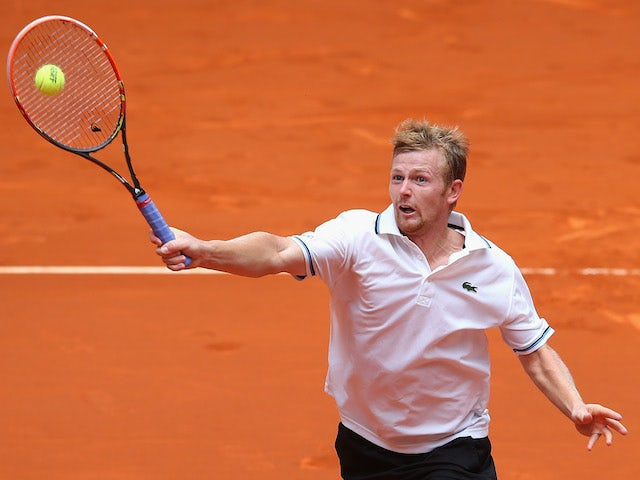 Andrey Golubev of Kazakhstan plays a volley against Nicolas Almagro of Spain during day four of the Mutua Madrid Open tennis tournament at the Caja Magica on May 6, 2014